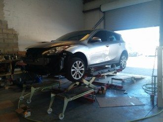 Wrecked SUV being evaluated for collision repair
