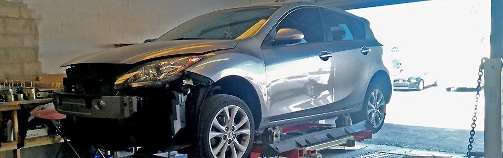 Late Model Car getting evaluated for repairs