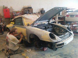 Porsche auto body being sanded