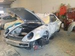 Porsche auto body being repaired
