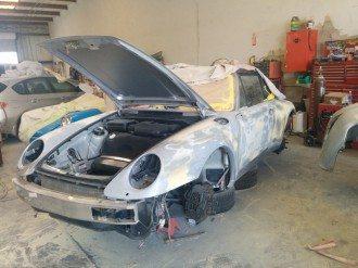Porsche auto body being repaired